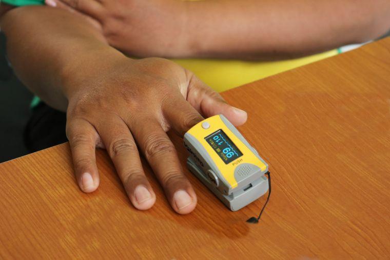 A person using a pulse oximeter