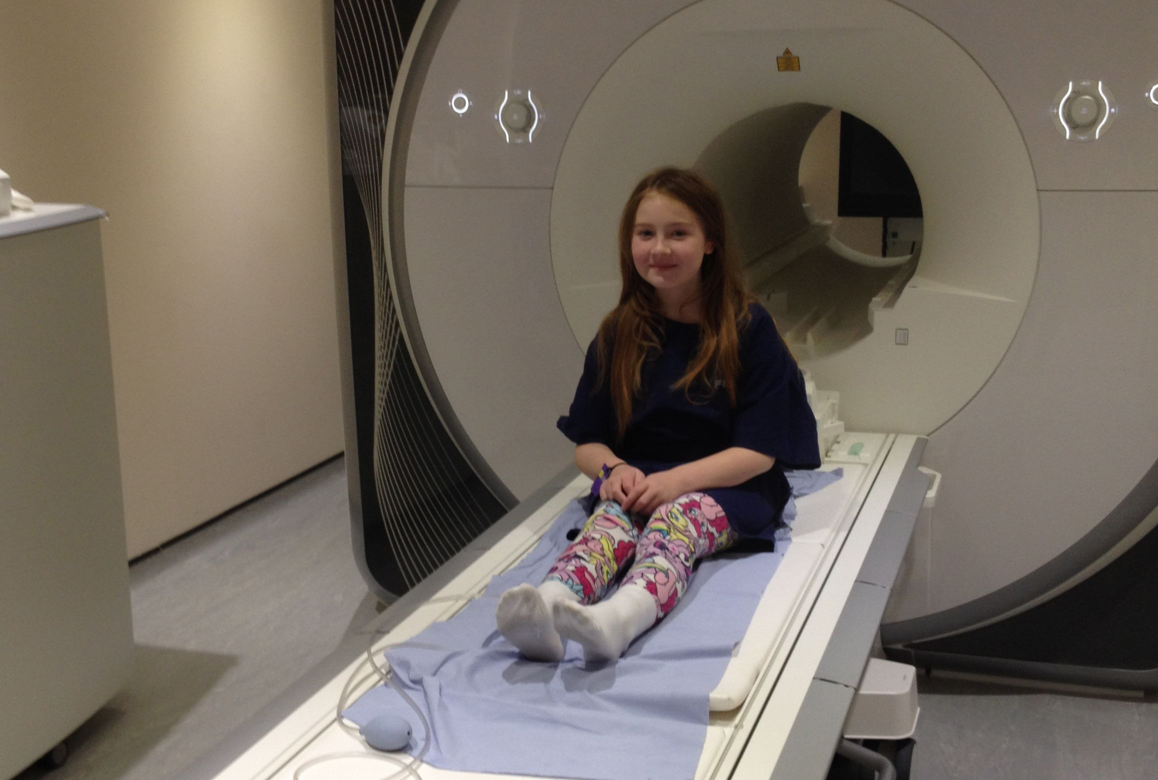 Child in front of an MRI scanner