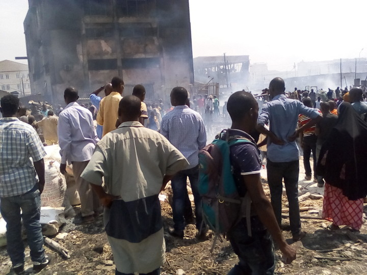 People looking at Salabed after heavy fire