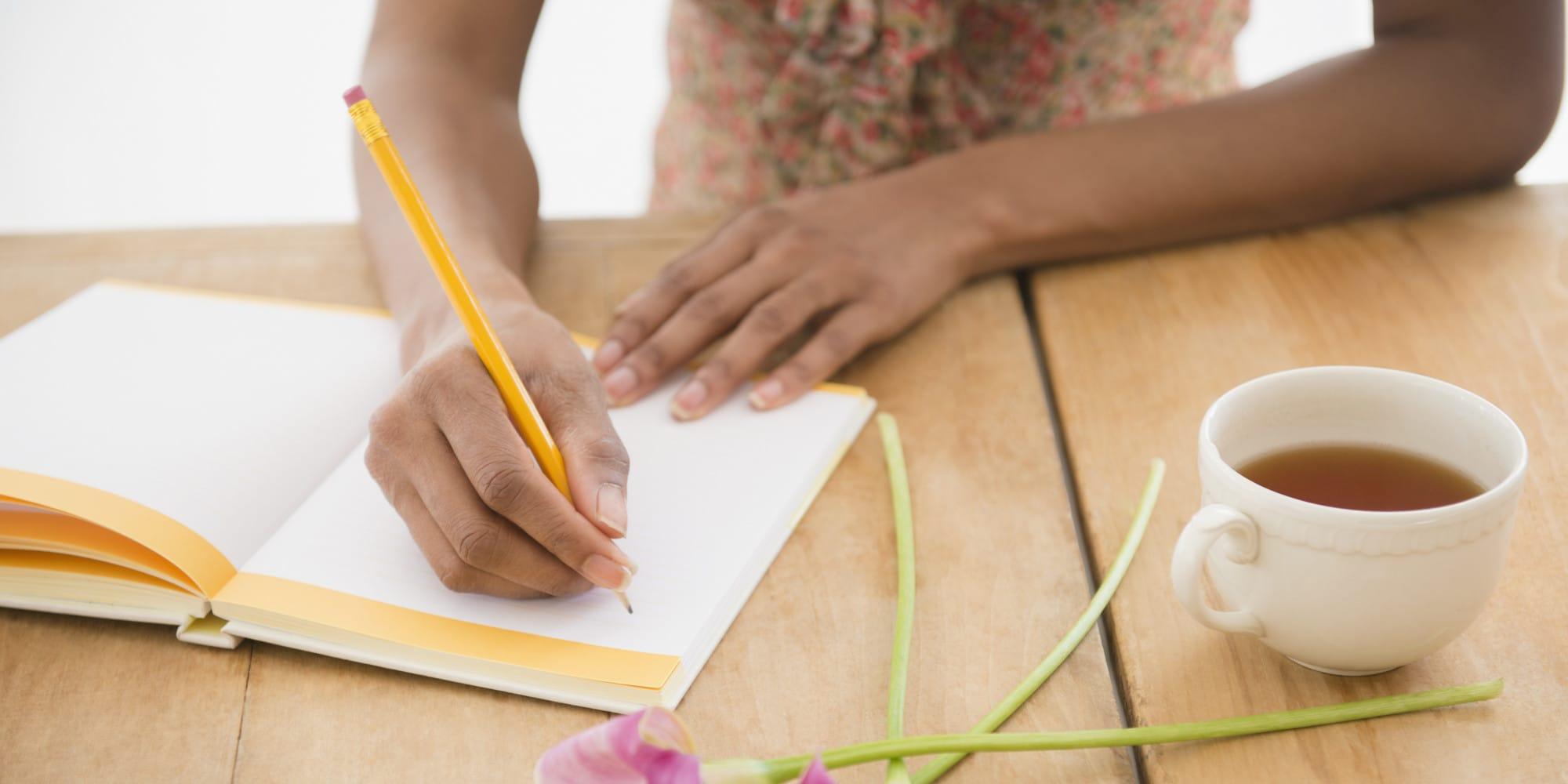 USA, New Jersey, Jersey City, Woman writing diary