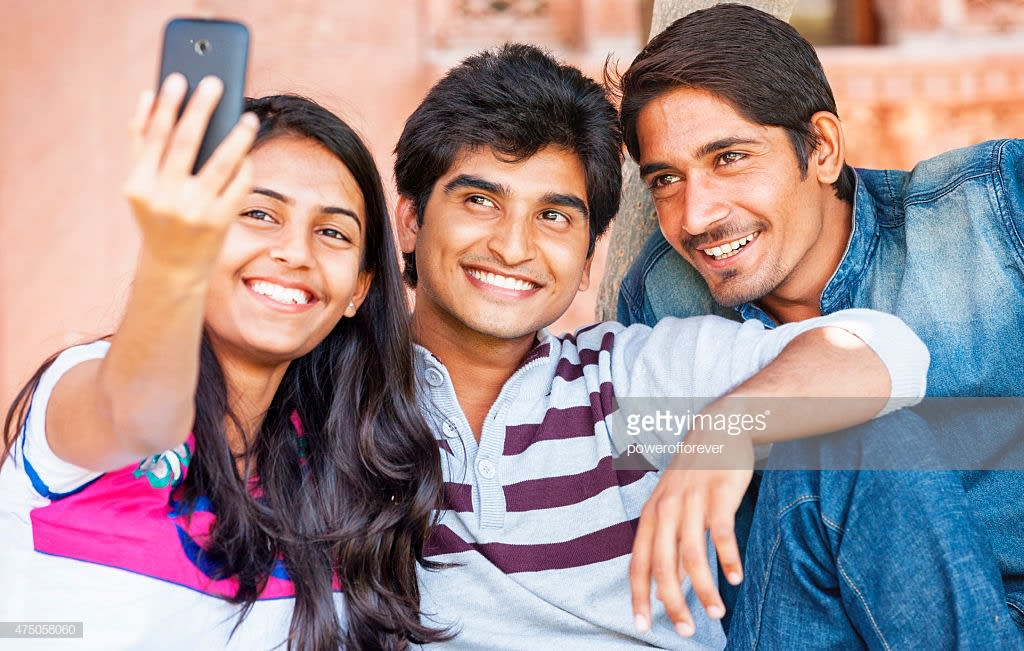 Group of young Indian friends taking a selfie together.