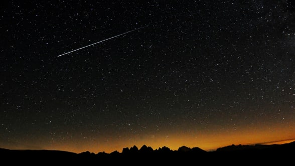 image of shooting star in night sky