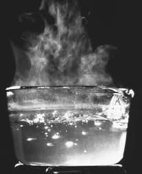 Boiling water in a glass jar