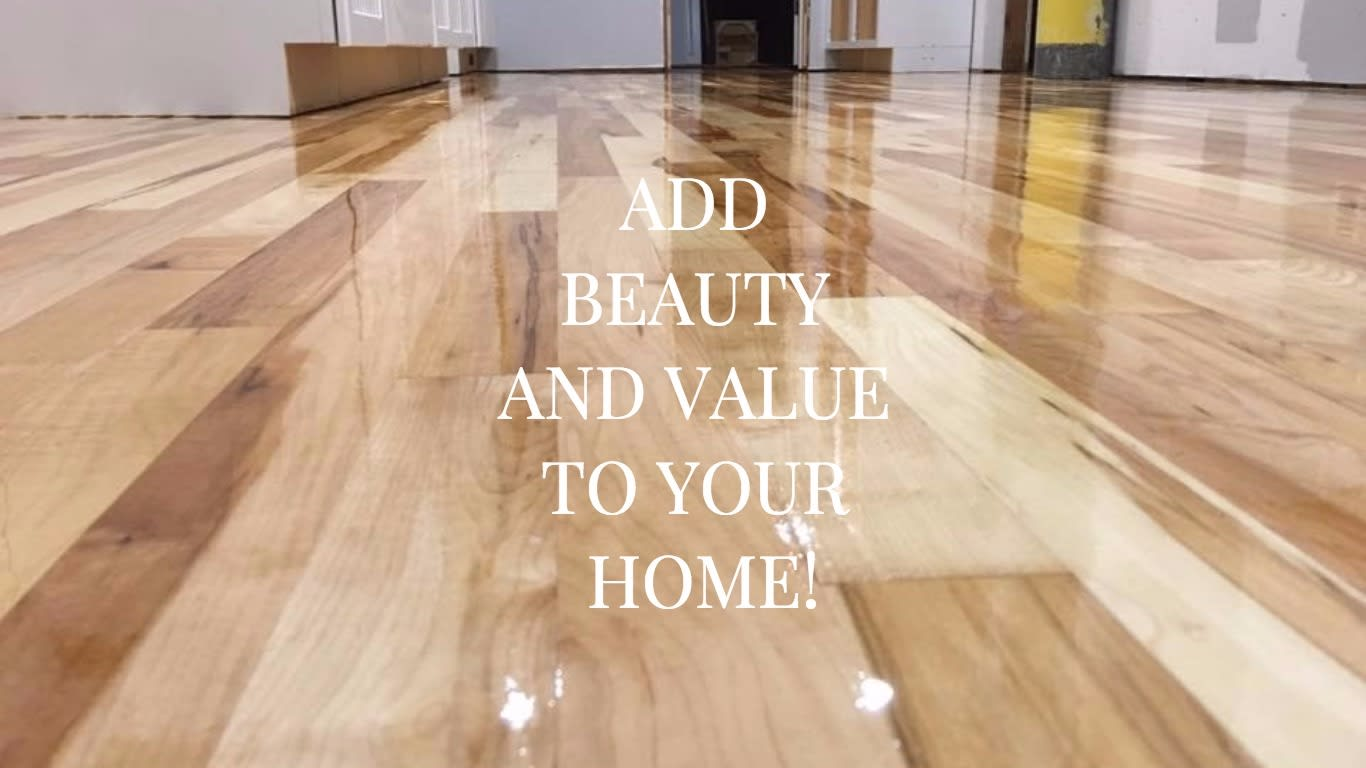 Image showing a lightly stained floor, also informing that getting your floors re-finished adds not only value             but beauty to your home also