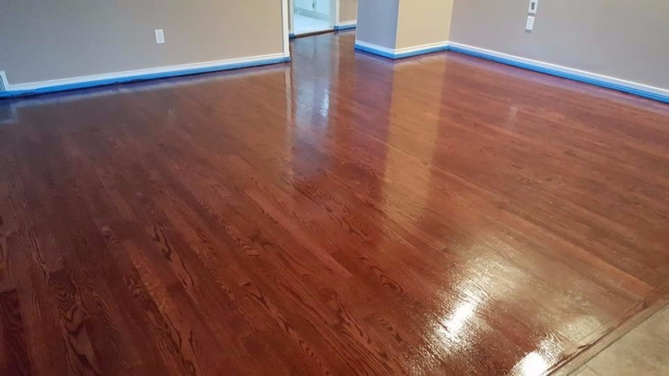 Image showing a dark stained floor, still showing signs of being wet
