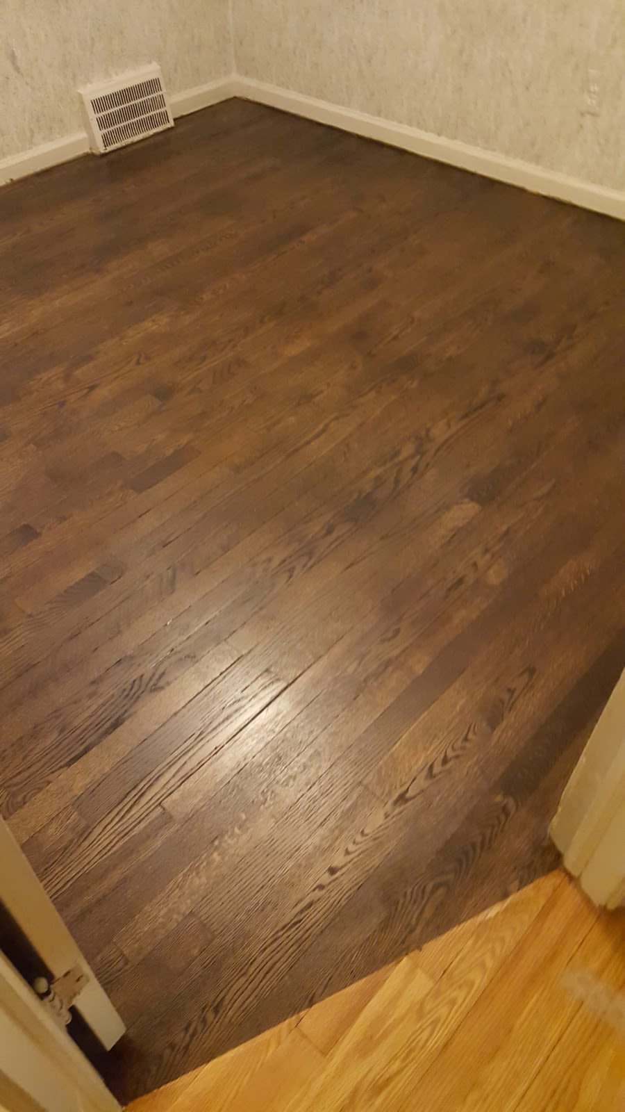 Image showing that same old damaged hardwood floor finished with a dark stain