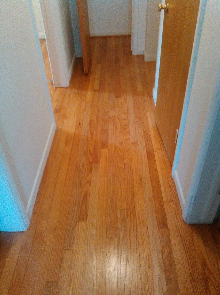 Image showing that same area in the previous picture finished with light hardwood