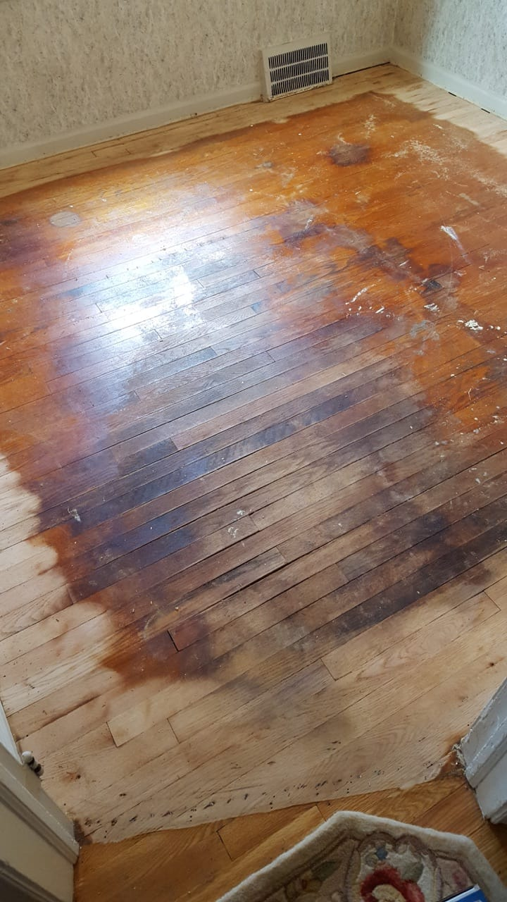 Image showing an old, discolored and damaged hardwood floor