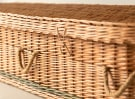 Close-up of wicker coffin
