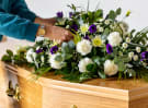 Bouquet resting on a coffin