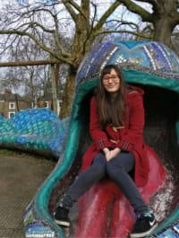 Helena sitting on the snake in Snake Park
