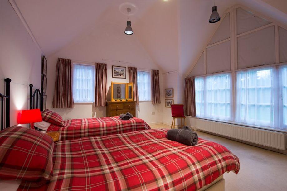 Large ground floor twin bedroom with large windows overlooking the garden