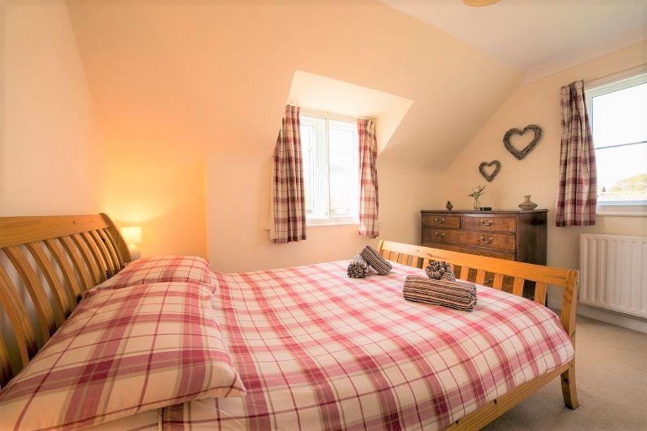 Delightful double bedroom with windows overlooking the rear garden