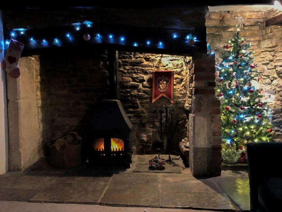 Spend December relaxing by a log fire