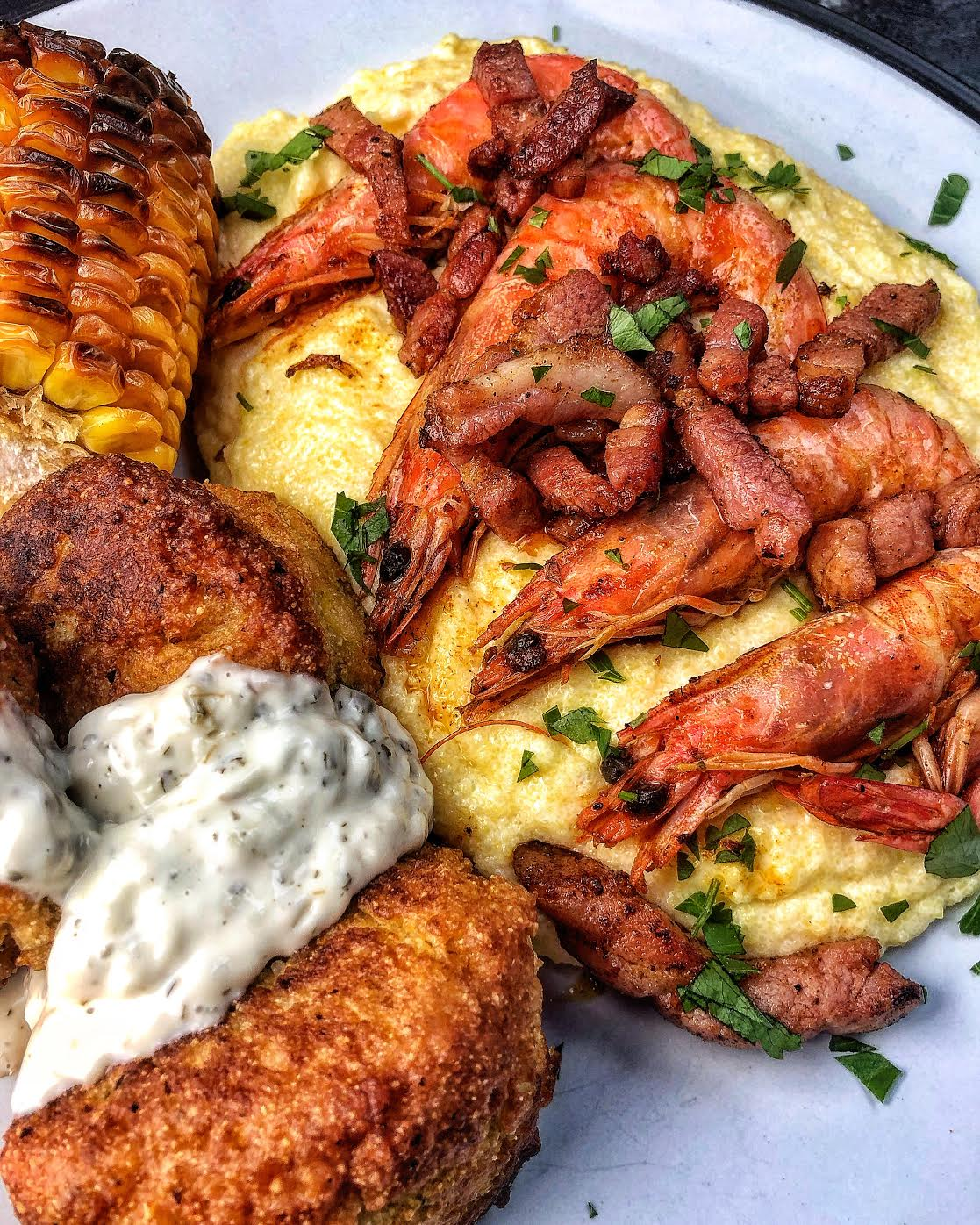 Berbere Spiced Prawns & Bacon, with Cheesy Grits, Hush Puppies and Corn