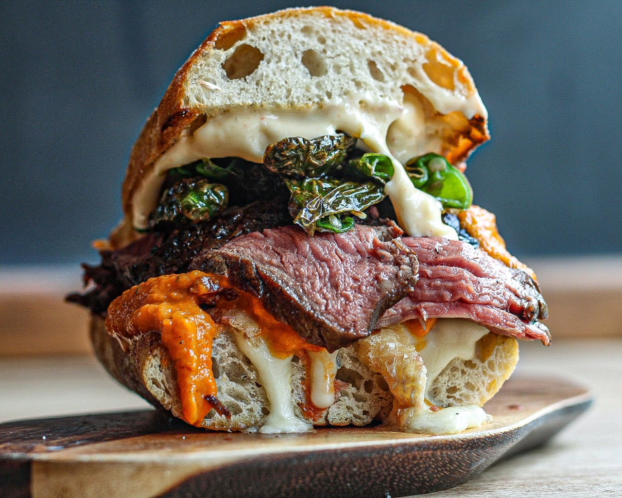 Steak Sandwich with Tallegio Cheese, Roasted Ketchup, Chorizo Oil Aioli and Padron Peppers