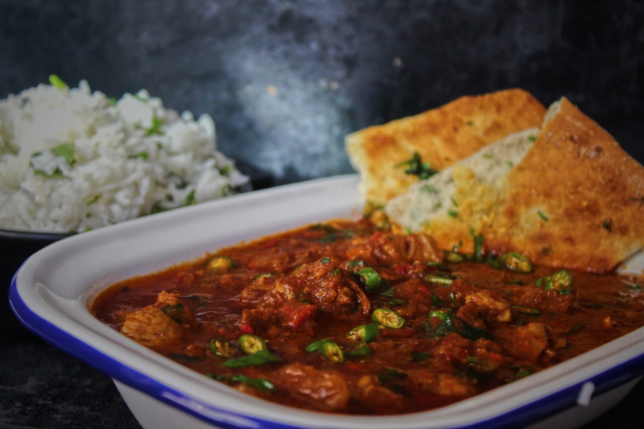 Lamb Curry served with Garlic & Coriander Naan Bread