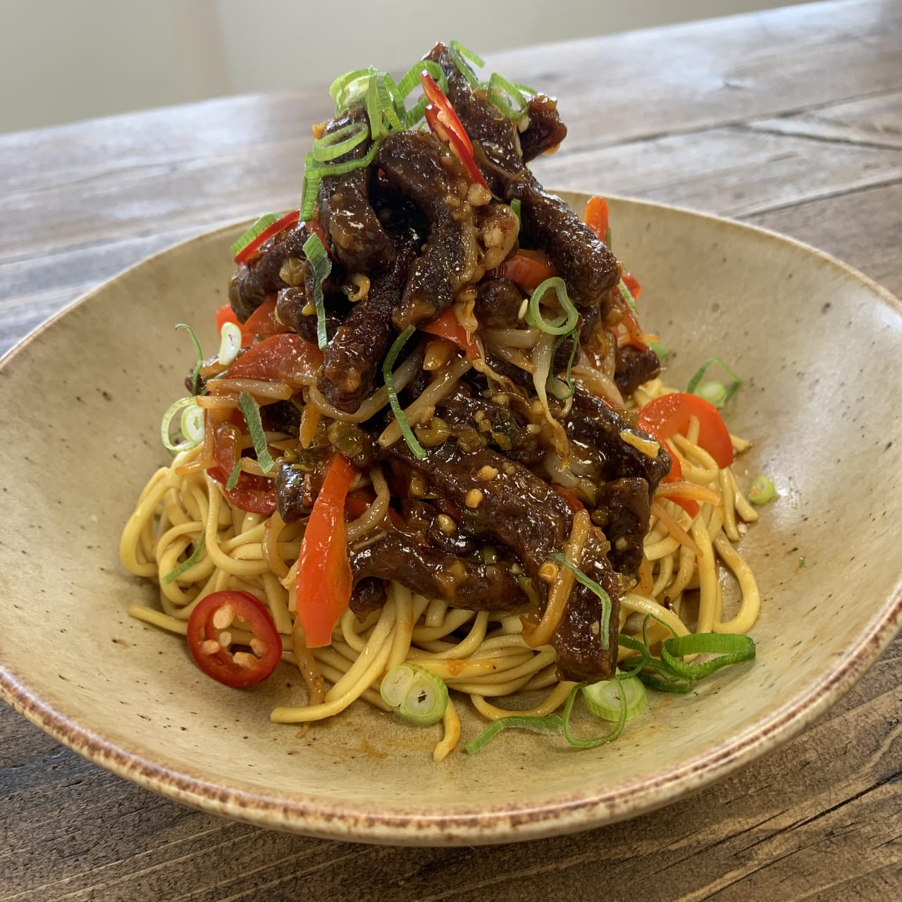 Crispy Chilli Beef served with noodles
