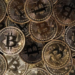 Bitcoin jumps toward $9000 in best-performing month since 2017