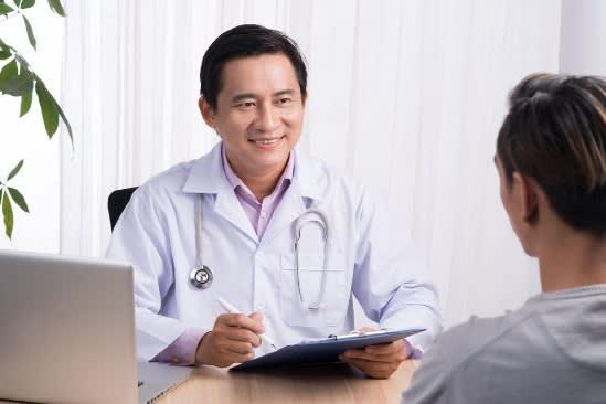 Breast Surgeon during consultation