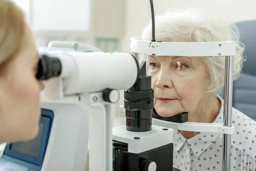 Old woman getting eye checked