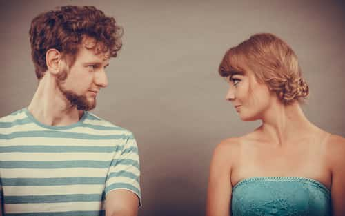 Woman and man staring at each other