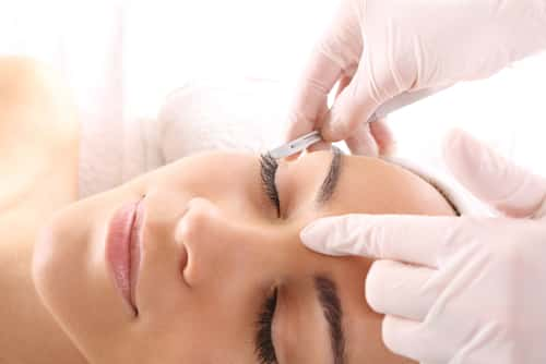 Woman undergoing eyelid surgery