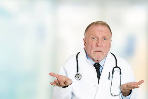 Doctor shrugging because he does not know what is going on