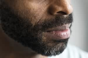 bearded man looking to one side