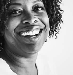 woman smiling widely