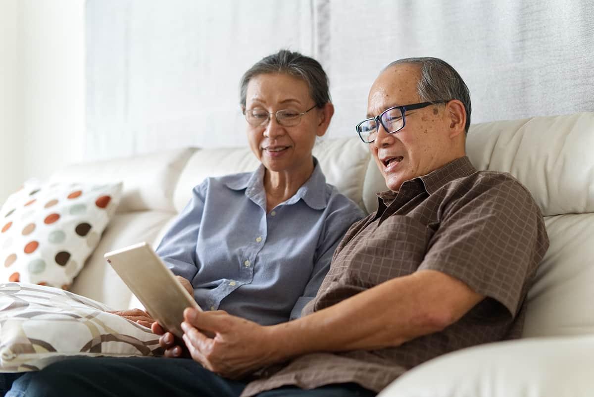 elderly couple reading together