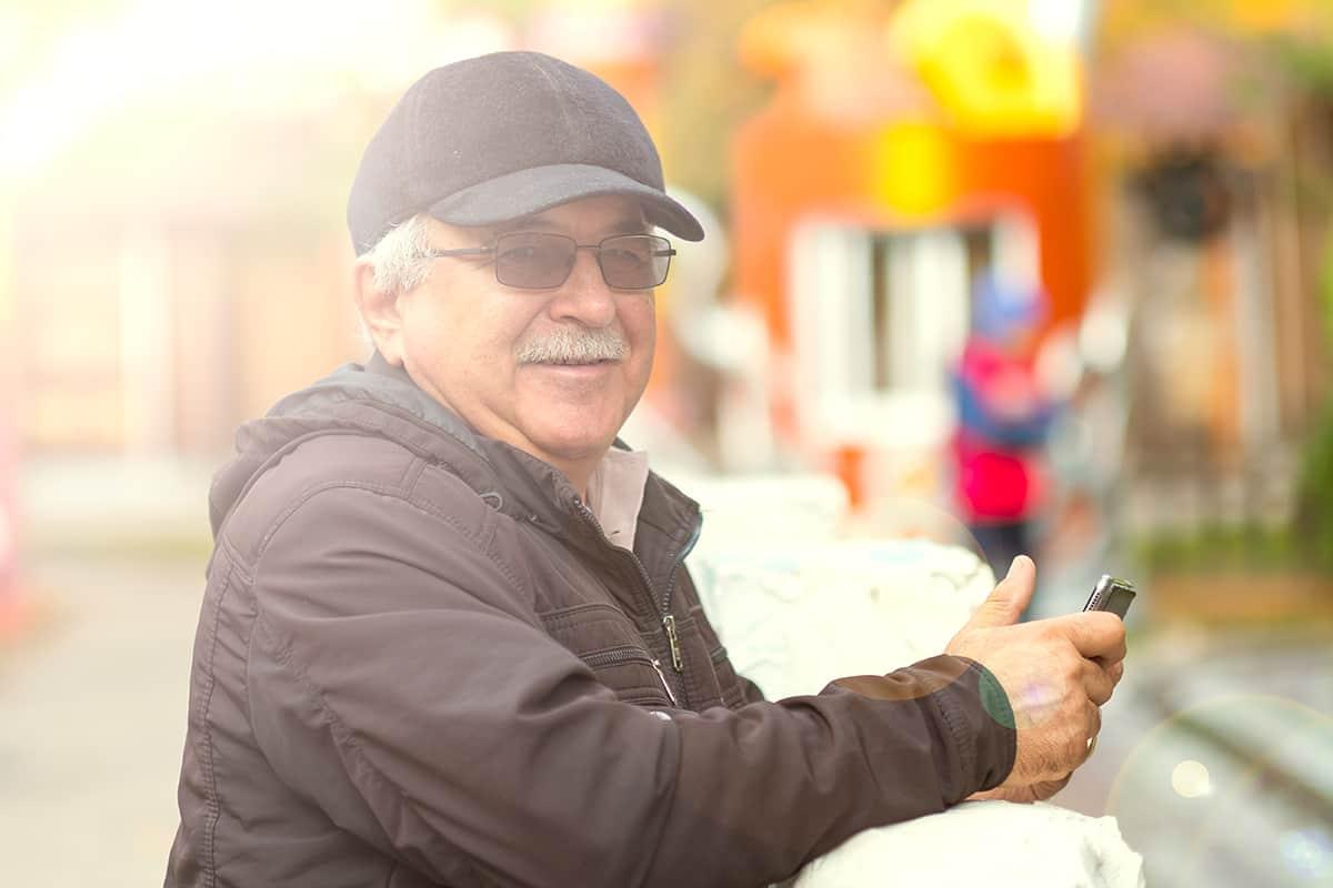 elderly man wearing sunglasses