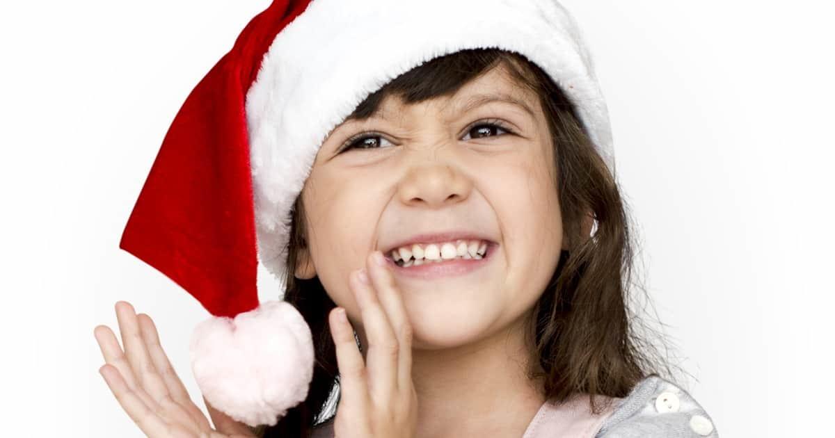 smiling girl in a santa hat