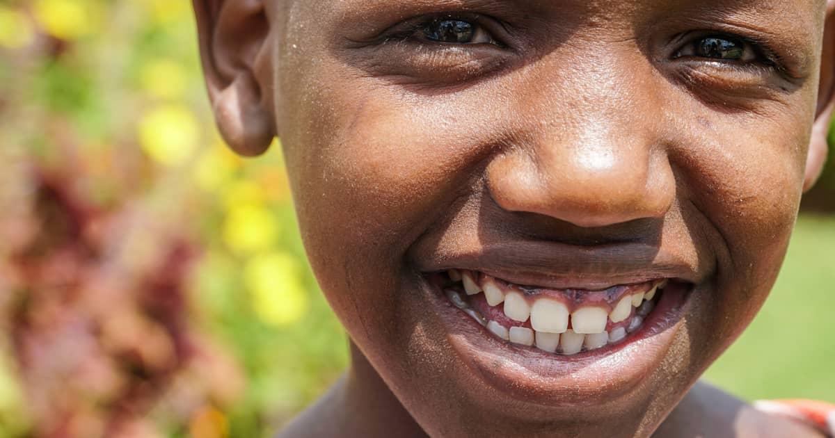 closeup of a boy smiling at the camera