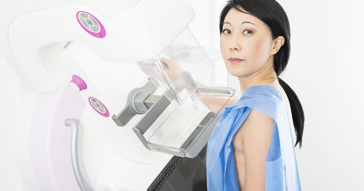 a woman having a breast scan