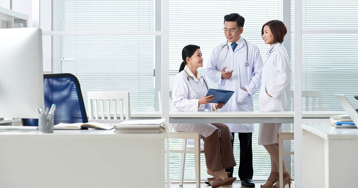 asian doctors talking in an office
