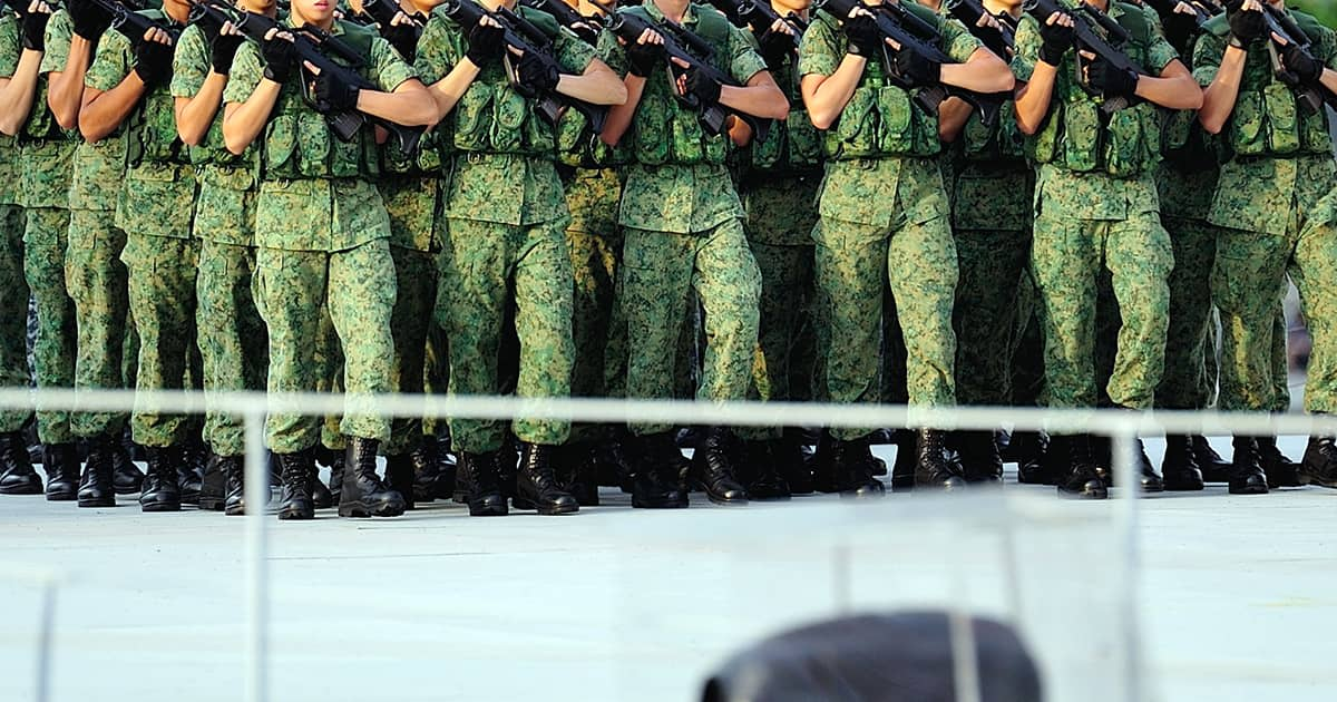 ns men in singapore marching