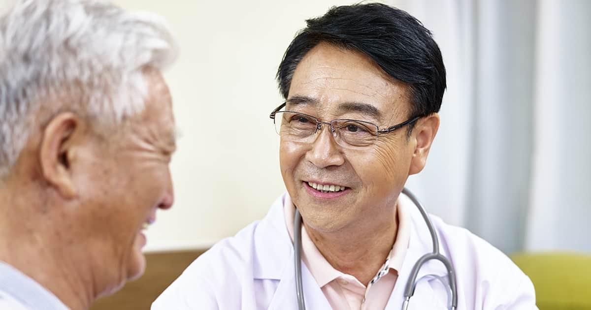 a doctor talking to a senior citizen