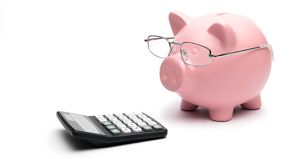 piggy bank with glasses and calculator