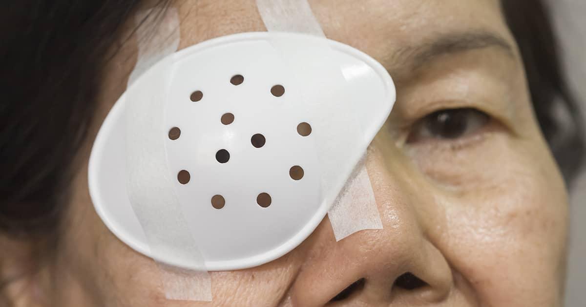 a lady wearing an eye shield