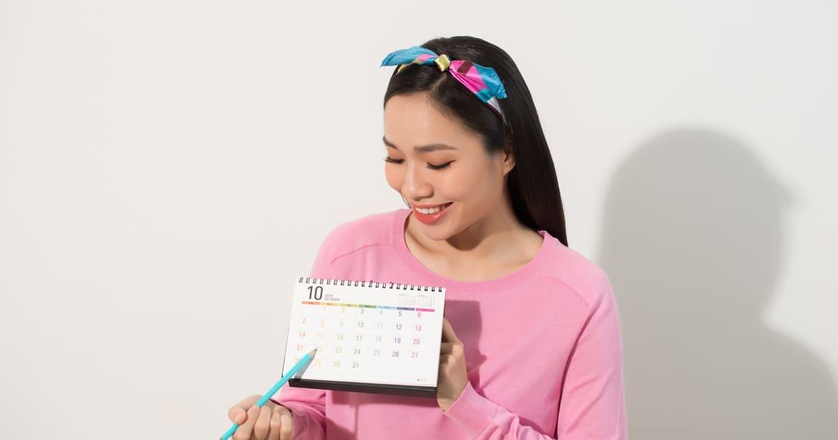 a woman checking her calendar