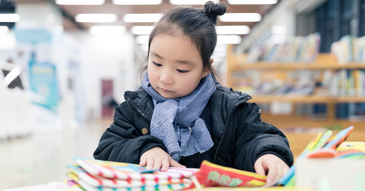 little asian girl reading