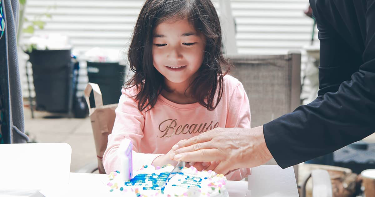 a young child with a cake