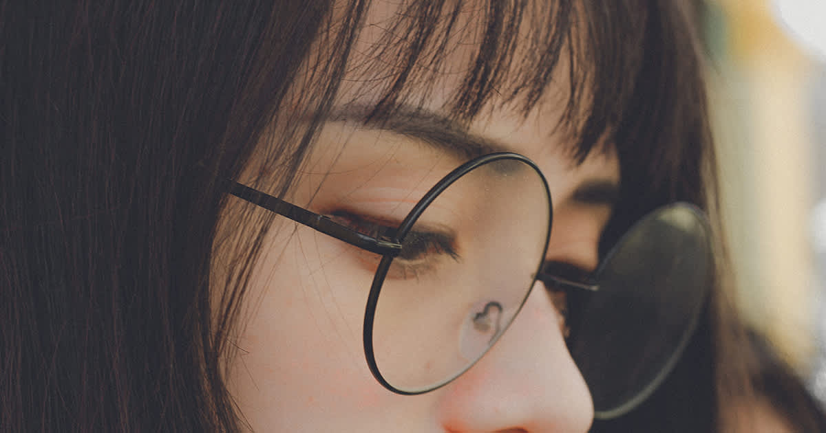 a young woman with glasses and a fringe