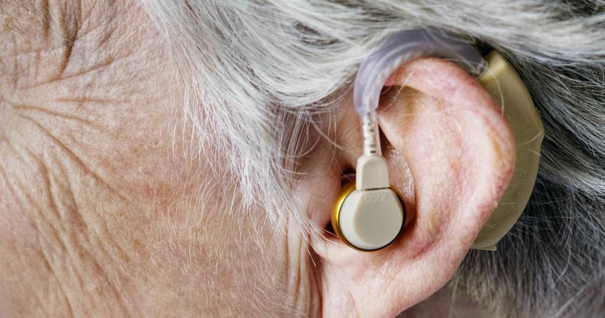 hearing aid in an elderly person