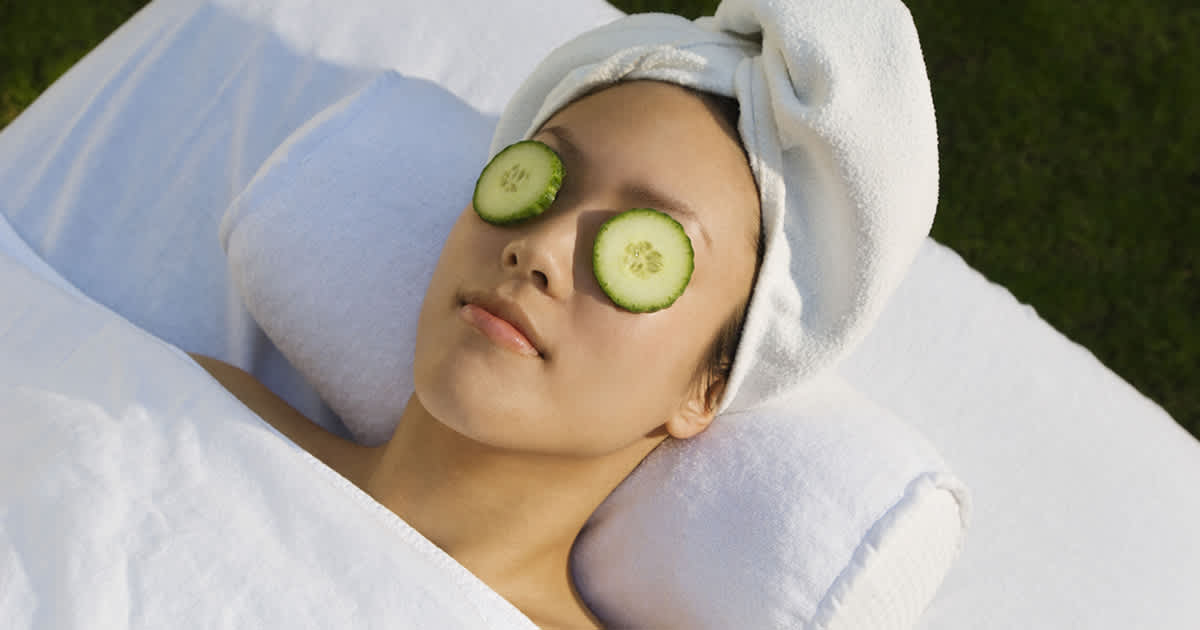 woman with cucumber on eyes