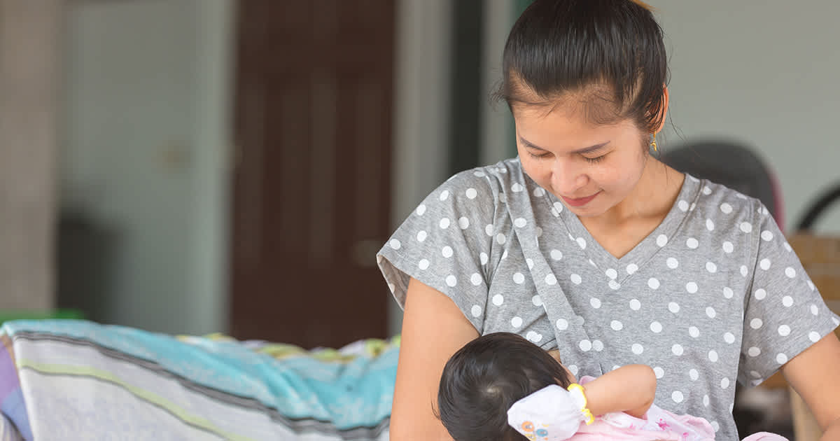 woman with baby at home