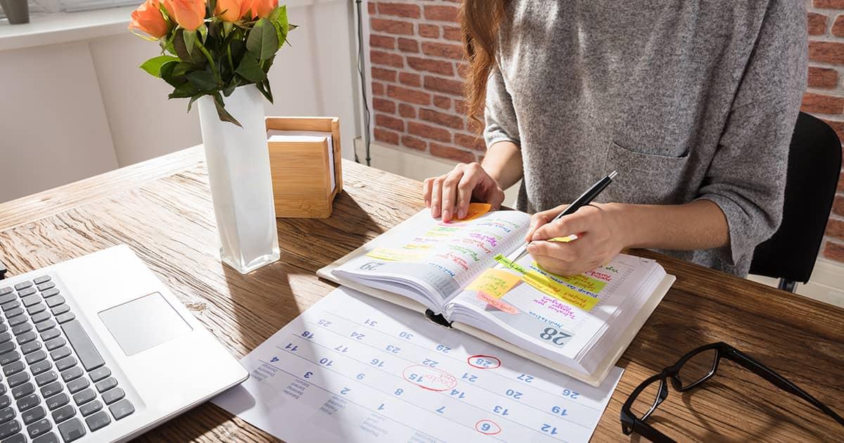 a woman with an organiser book