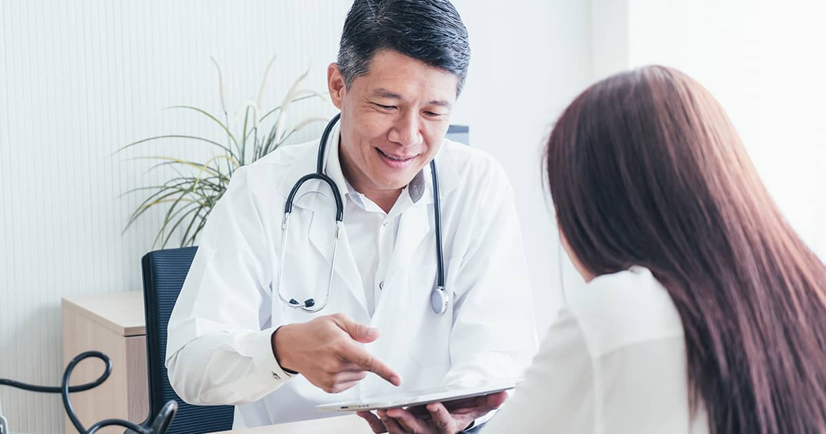 a woman talking to a doctor in a clinic