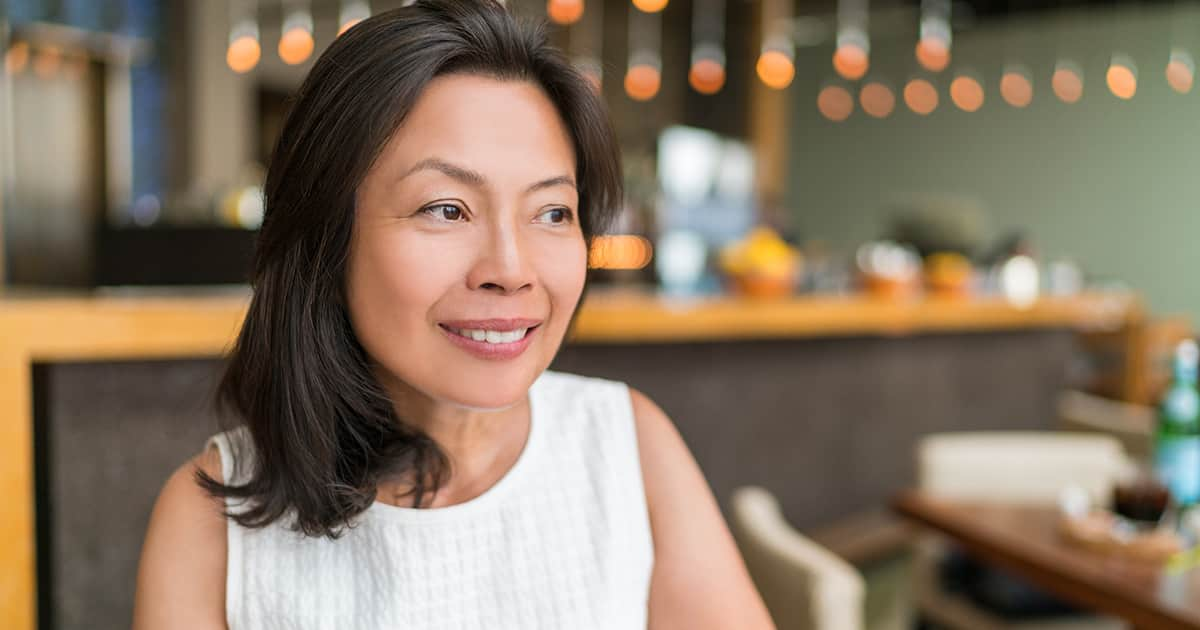 woman smiling in a restaurant